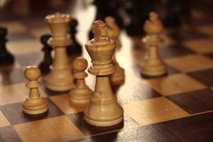 Photograph of chess pieces on a chess board